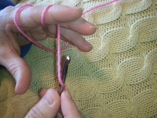 Go under the yarn.