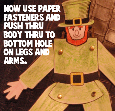 Now use paper fasteners and push thru body thru to bottom hole on legs and arms.