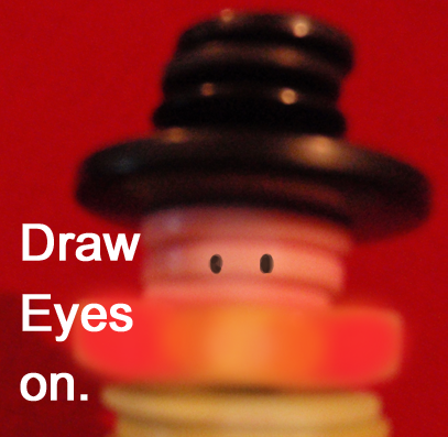 Draw eyes on the pink buttons.
