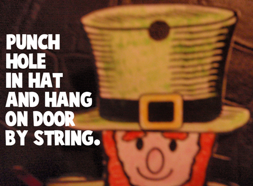 Punch hole in hat and hang on door by string.