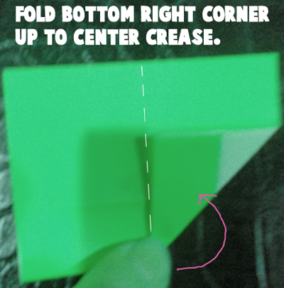 Fold bottom right corner up to center crease.