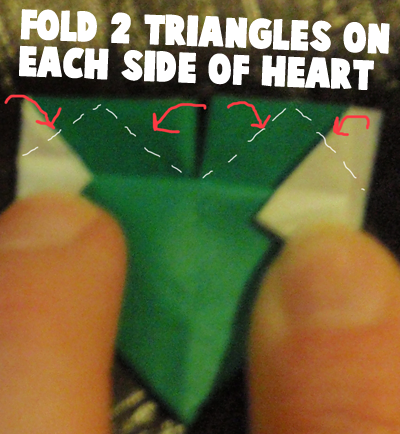 Fold 2 triangles on each side of heart.