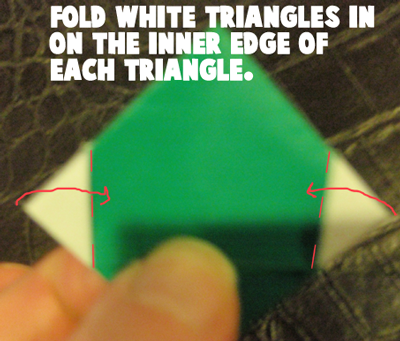 Fold white triangles in on the inner edge of each triangle.