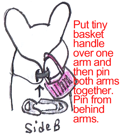 Put tiny basket handle over one arm and then pin both arms together.