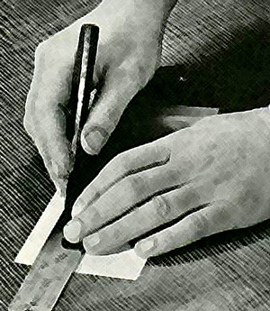 The paper is ruled off with a pencil and a ruler.