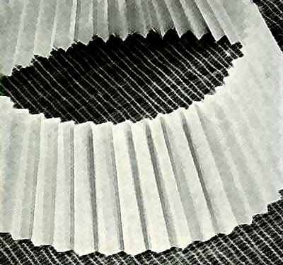 The edges of the paper are taped together to achieve a sort of lampshade effect.