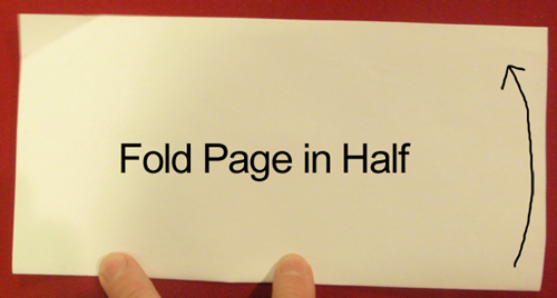 Fold page in half.