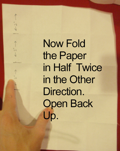Now fold the paper in half twice in the other direction.