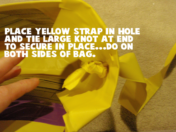 Place yellow strap in hole and tie large knot at end to secure in place.... do on both sides of bag.
