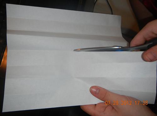 Cut center fold about half way down.