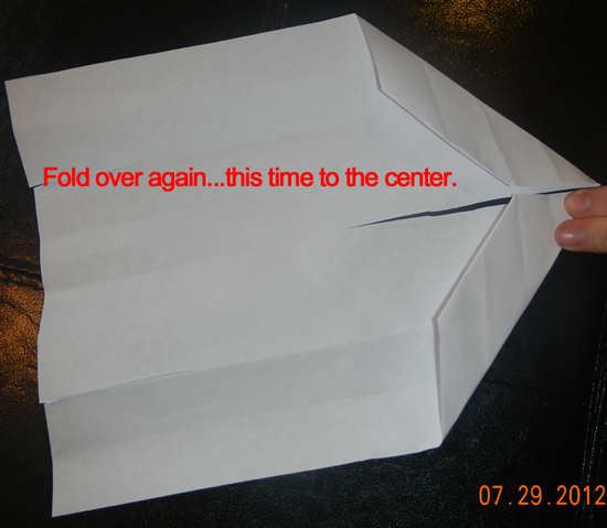 Fold over again.... this time to the center.