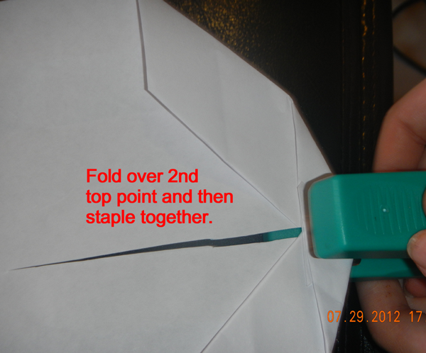 Fold over 2nd top point and then staple together.