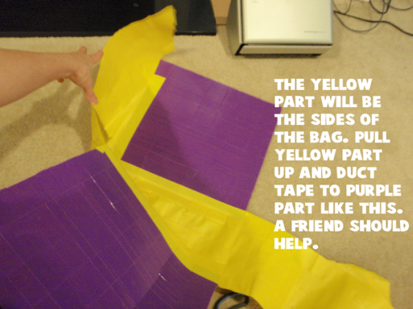 Pull yellow part up and duct tape to purple part like this.