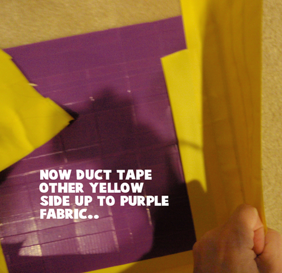 Now duct tape other yellow side up to purple fabric.