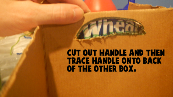 Cut out handle and then trace handle onto back of the other box.