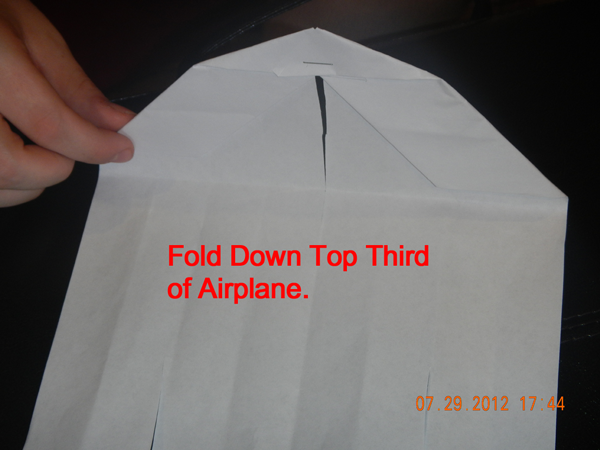 Fold down top third of airplane.