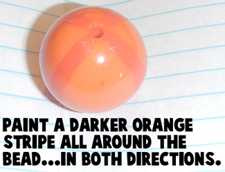 Paint a darker orange stripe all around the bead