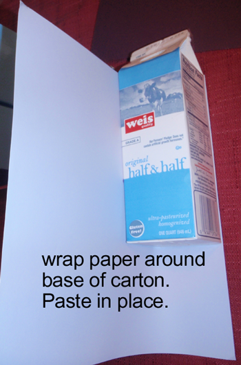 Wrap paper around base of carton.