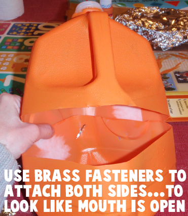 Use brass fasteners to attach both sides... to look like mouth is open.