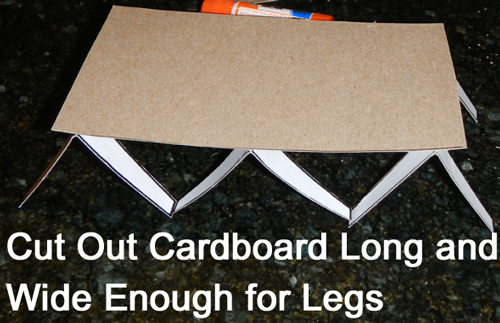 Cut out cardboard long and wide enough for legs.