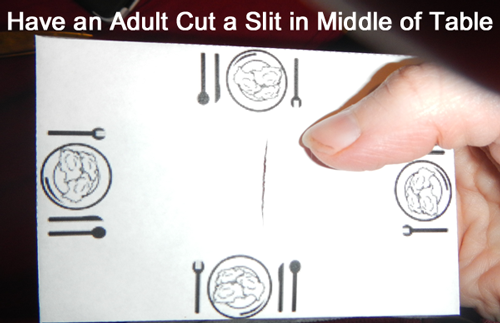 Have an adult cut a slit in middle of table.