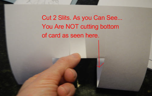 Cut 2 slits.  As you can see... You are NOT cutting bottom of card as seen here.