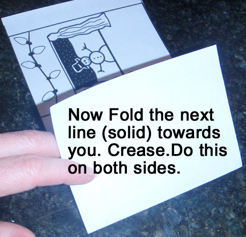 Now fold the next line (solid) towards you.