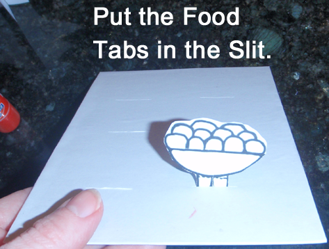 Put the food tabs in the slit.