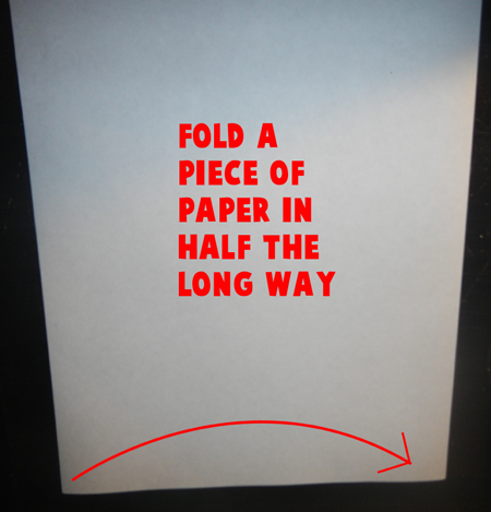 Fold a piece of paper in half the long ways.
