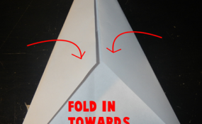 Fold in towards center line another time.